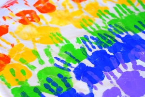 Colorful_handprints_on_a_tablecloth