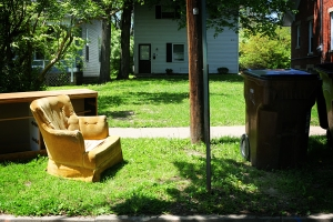 Furniture left out by the curb. http://chrisglass.com/album/wp-content/uploads/2009/05/0512-chair-curb.jpg
